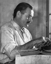 """ErnestHemingway"" by Lloyd Arnold - http://www.phoodie.info/2013/07/19/from-the-desk-of-ernest-hemingway-this-weekend-cuba-libre-celebrates-my-birthday/. Licensed under Public Domain via Commons - https://commons.wikimedia.org/wiki/File:ErnestHemingway.jpg#/media/File:ErnestHemingway.jpg"